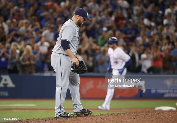Tommy Hunter of the Tampa Bay Rays reacts as Justin Smoak of the Toronto Blue Jays circles the bases after hitting a tworun home run in the eighth...