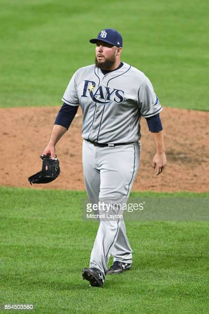 Tommy Hunter of the Tampa Bay Rays walks back to the dug out during a baseball game against the Baltimore Orioles at Oriole Park at Camden Yards on...