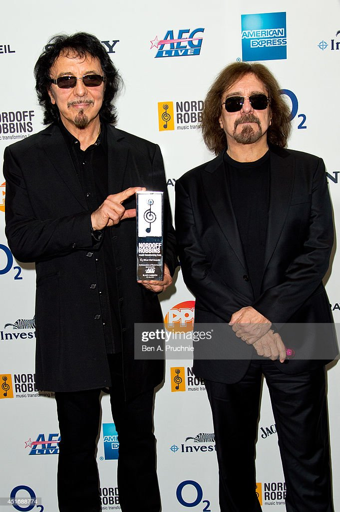Tommy Iommi and <a gi-track='captionPersonalityLinkClicked' href=/galleries/search?phrase=Geezer+Butler&family=editorial&specificpeople=810495 ng-click='$event.stopPropagation()'>Geezer Butler</a> attends the Nordoff Robbins 02 Silver Clef awards at London Hilton on July 4, 2014 in London, England.