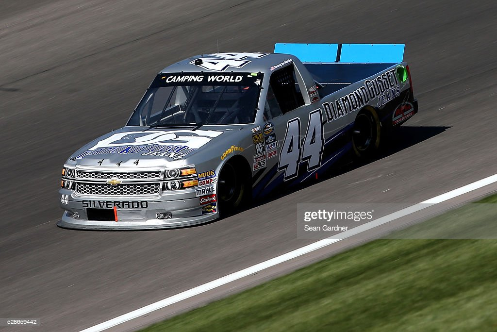 Tommy Joe Martins, driver of the (44) Diamond Gusset Jeans Chevrolet, drives during qualifying for the NASCAR Camping World Truck Series Toyota Tundra 250 at Kansas Speedway on May 6, 2016 in Kansas City, Kansas.