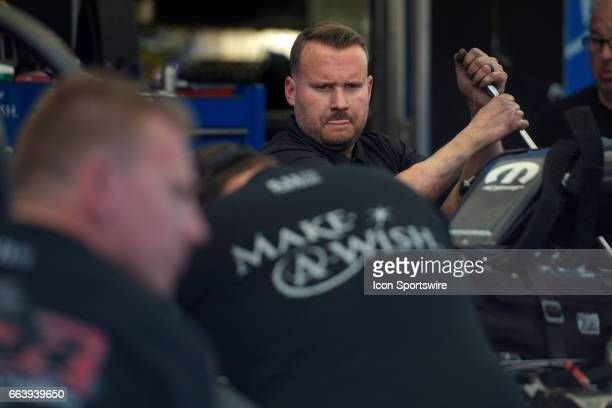 Tommy Johnson Jr Don Schumacher Racing Dodge Charger NHRA Funny Car crew members work on his care between runs during the 18th annual DENSO Spark...