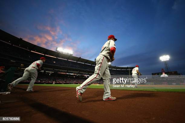 Tommy Joseph Hyun Soo Kim and Daniel Nava of the Philadelphia Phillies take the field during the third inning of a game against the Los Angeles...