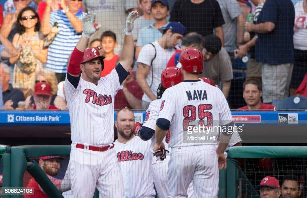 Tommy Joseph of the Philadelphia Phillies celebrates with Freddy Galvis and Daniel Nava after a tworun home by Galvis in the bottom of the first...