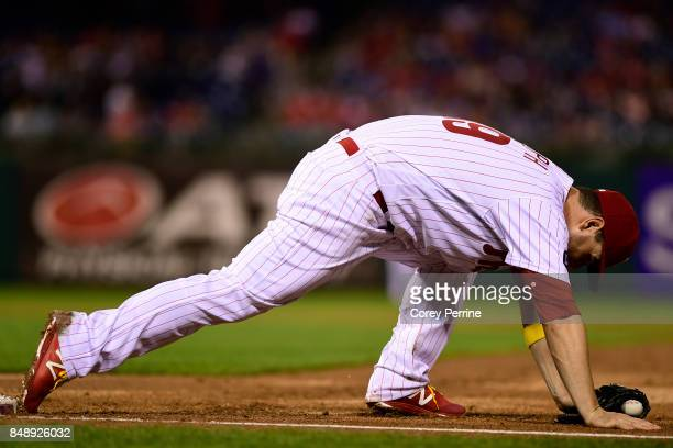 Tommy Joseph of the Philadelphia Phillies has enough stretch to keep his foot on the bag for an out at first base against the Oakland Athletics...