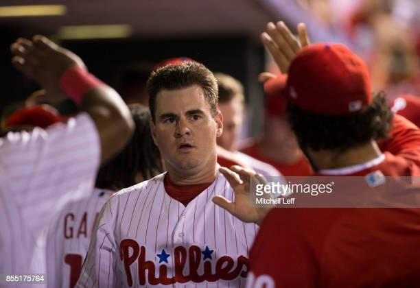 Tommy Joseph of the Philadelphia Phillies high fives his teammates in the dugout against the Los Angeles Dodgers at Citizens Bank Park on September...