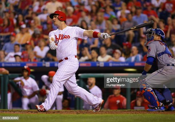 Tommy Joseph of the Philadelphia Phillies hits an RBI sacrifice fly in the eighth inning during a game against the New York Mets at Citizens Bank...