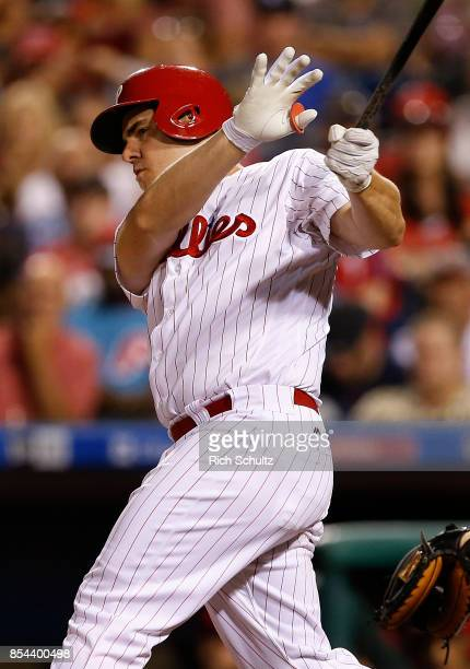 Tommy Joseph of the Philadelphia Phillies hits an RBI single against the Washington Nationals during the third inning of a game at Citizens Bank Park...