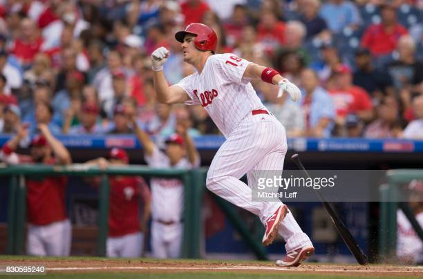 Tommy Joseph of the Philadelphia Phillies hits an RBI single in the bottom of the first inning against the New York Mets at Citizens Bank Park on...