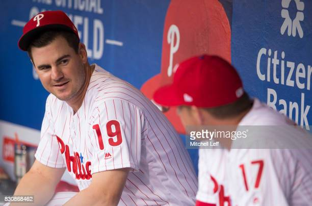 Tommy Joseph of the Philadelphia Phillies talks to Rhys Hoskins in the dugout prior to the game against the New York Mets at Citizens Bank Park on...