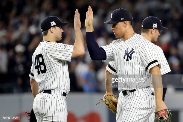 Tommy Kahnle and Aaron Judge of the New York Yankees celebrate after defeating the Houston Astros in Game Five of the American League Championship...