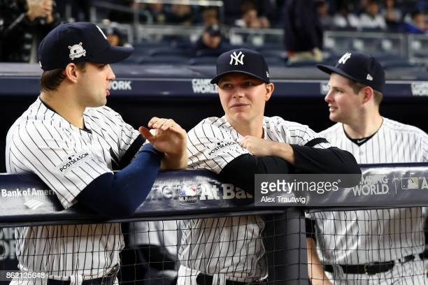 Tommy Kahnle and Sonny Gray of the New York Yankees talk in the dugout prior to Game 3 of the American League Championship Series against the Houston...