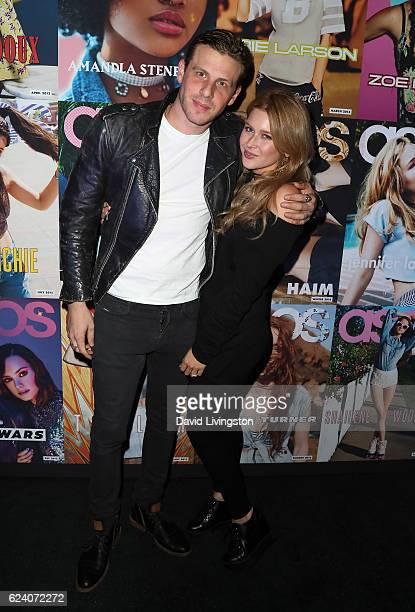 Tommy King and wife actress Renee Olstead attend the launch of ASOS Magazine US Edition at The Sayers Club on November 17 2016 in Hollywood California