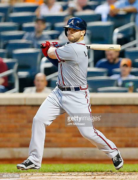 Tommy La Stella of the Atlanta Braves follows through on a second inning double against the New York Mets at Citi Field on August 27 2014 in the...