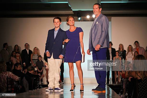 Tommy Lang Kelly Jackman and hockey player Tim Jackman attend the Anaheim Lady Ducks Fashion Show Luncheon with Bloomingdale's South Coast Plaza at...