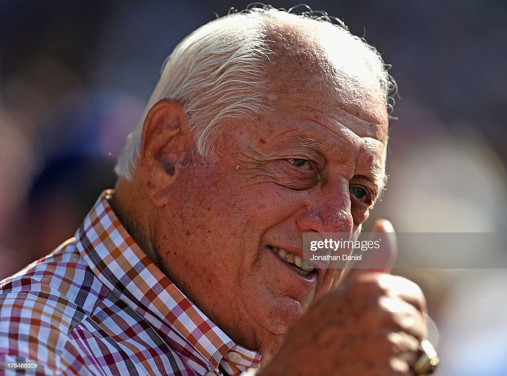 Tommy Lasorda gives a 'thumbs up' to an umpire as the Chicago Cubs take on the Los Angeles Dodgers at Wrigley Field on August 3, 2013 in Chicago, Illinois. The Dodgers defeated the Cubs 3-0.