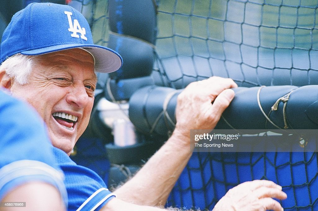 Tommy Lasorda of the Los Angeles Dodgers looks on against the St Louis Cardinals at Busch Stadium on May 12 1996 in St Louis Missouri