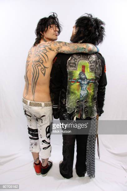 Tommy Lee and Nikki Sixx of Motley Crue pose for a studio portrait session backstage at the Download Festival Donington Park Leicestershire on June...