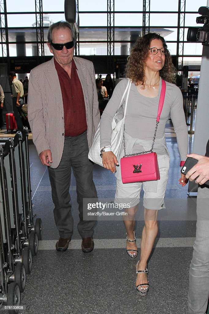 Tommy Lee Jones and Dawn Laurel Jones are seen at LAX on July 20 2016 in Los Angeles California