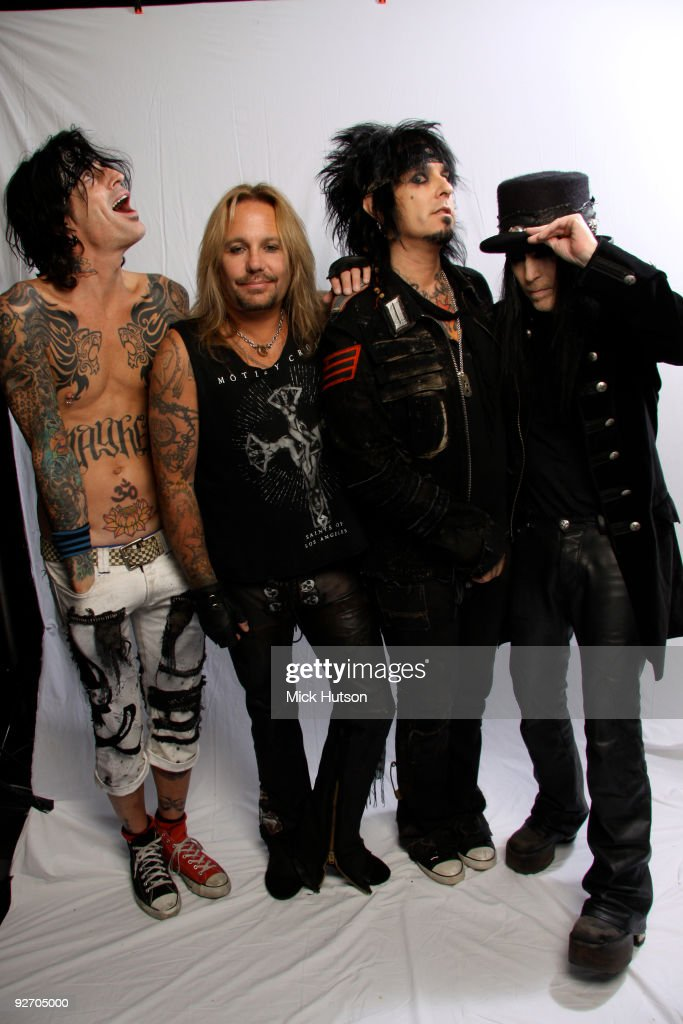 Tommy Lee Vince Neil Nikki Sixx and Mick Mars of Motley Crue pose for a studio group portrait backstage at the Download Festival Donington Park...