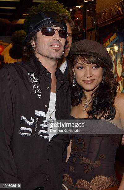 Tommy Lee with fiancee Mayte Garcia during 2002 VH1 Vogue Fashion Awards Arrivals at Radio City Music Hall in New York City New York United States
