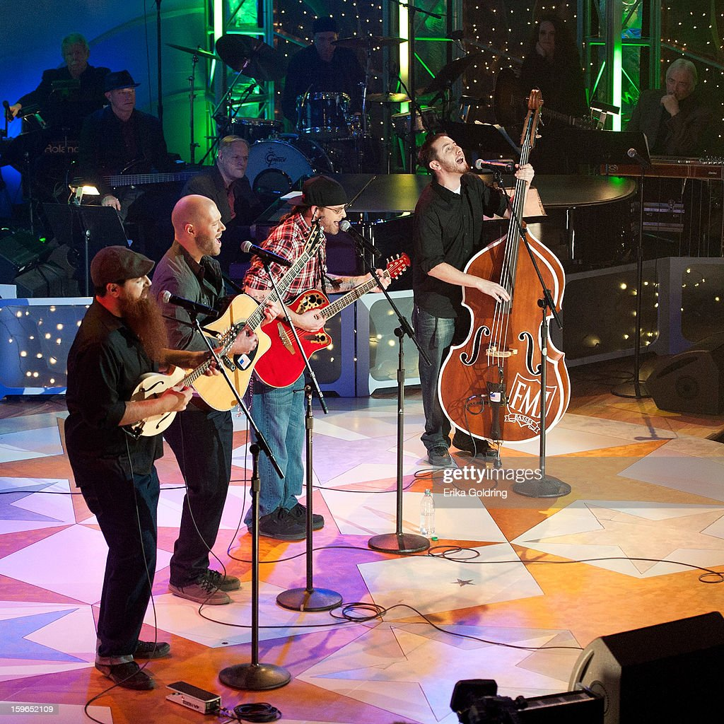 Tommy McCarthy, Mike Jacobs, Ryan Hakker, and Dustin Medeiros of Poor Man's Poison perform at the 31st annual Texaco Country Showdown fational final at the Ryman Auditorium on January 17, 2013 in Nashville, Tennessee.