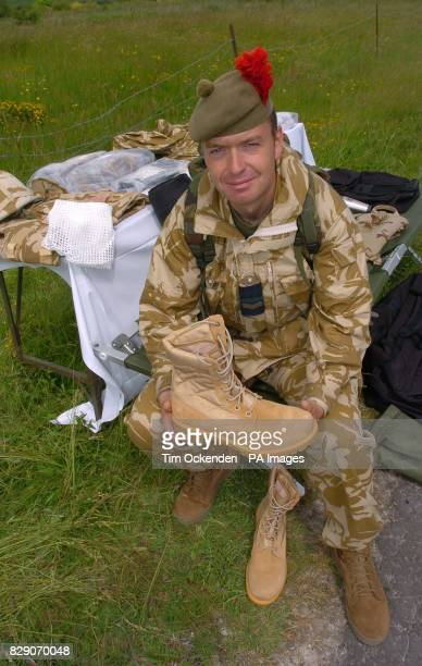 Tommy McLellan a member of the 1st Battalion The Black Watch with kit during a training exercise on Salisbury Plain before the Battallion's...