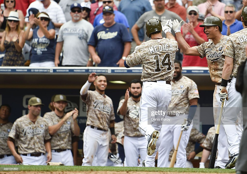 Tommy Medica #14 of the San Diego Padres celebrates after hitting a solo home run during the eighth inning of a baseball game against the Atlanta Braves at Petco Park August 3, 2014 in San Diego, California.