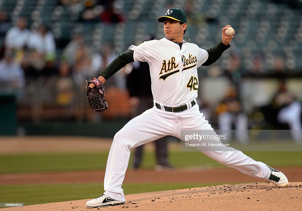 <a gi-track='captionPersonalityLinkClicked' href=/galleries/search?phrase=Tommy+Milone&family=editorial&specificpeople=8240408 ng-click='$event.stopPropagation()'>Tommy Milone</a> of the Oakland Athletics pitches against the Houston Astros in the first inning at O.co Coliseum on April 15, 2013 in Oakland, California. All uniformed team members are wearing jersey number 42 in honor of Jackie Robinson Day.