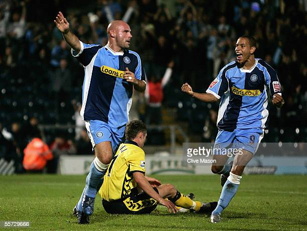 Tommy Mooney of Wycombe Wanderers celebrates his goal with team mate Nathan Tyson during the Carling Cup second round match between Wycombe Wanderers...