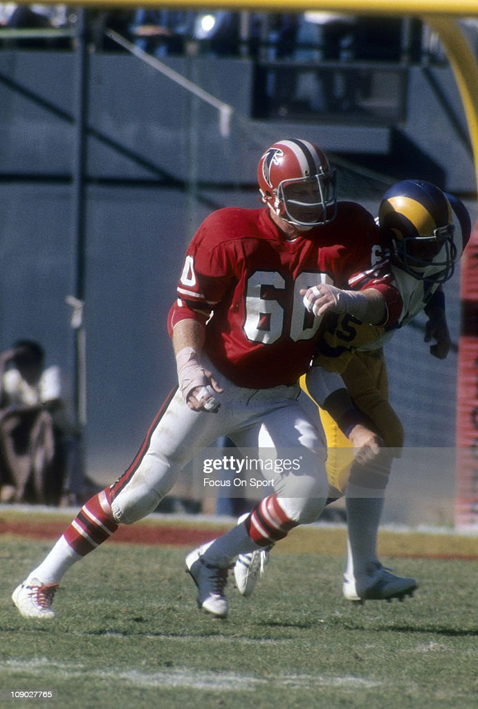 <a gi-track='captionPersonalityLinkClicked' href=/galleries/search?phrase=Tommy+Nobis&family=editorial&specificpeople=993224 ng-click='$event.stopPropagation()'>Tommy Nobis</a> #60 of the Atlanta Falcons in action against the Los Angeles Rams during an NFL football game at Atlanta-Fulton County Stadium September 23, 1973 in Atlanta, Georgia. Nobis played for the Falcons from 1966-76.