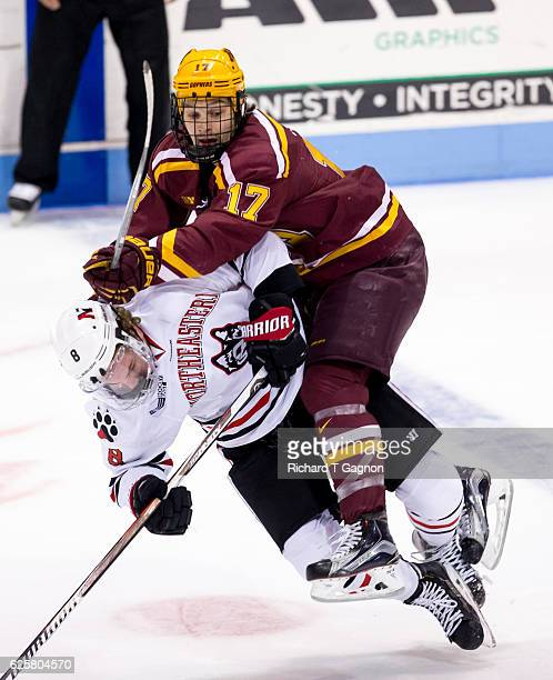 Tommy Novak of the Minnesota Golden Gophers checks Adam Gaudette of the Northeastern Huskies during NCAA hockey at Matthews Arena on November 25 2016...