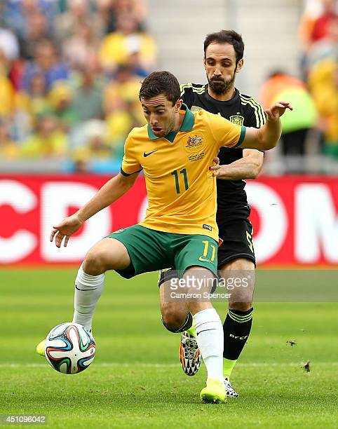 Tommy Oar of Australia controls the ball against Juanfran of Spain during the 2014 FIFA World Cup Brazil Group B match between Australia and Spain at...