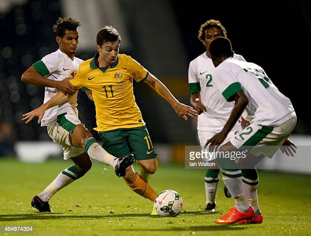 Tommy Oar of Australia is tackled by Ibrahim Ghaleb of Saudi Arabia during the International Friendly match between Saudi Arabia v Australia at...