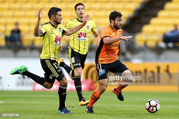 Tommy Oar of the Roar beats the defence of Vince Lia of the Phoenix during the round 16 ALeague match between the Wellington Phoenix and the Brisbane...
