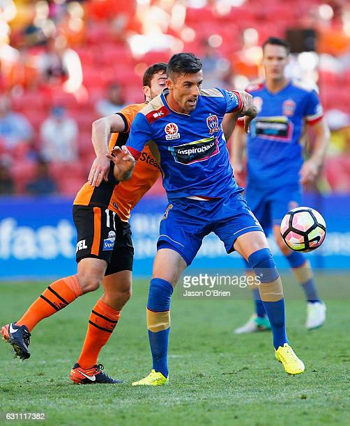 Tommy Oar of the Roar in action with Jason Hoffman of the Jets during the round 14 ALeague match between the Brisbane Roar and the Newcastle Jets at...