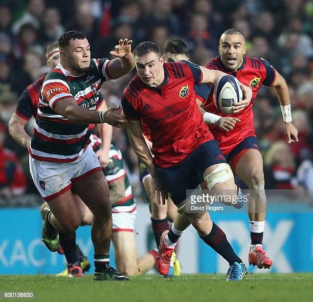 Tommy O'Donnell of Munster breaks clear of Ellis Genge during the European Rugby Champions Cup match between Leicester Tigers and Munster at Welford...