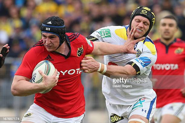 Tommy O'Donnell of Munster holds off Julien Bonnaire during the Heineken Cup semi final match between Clermont Auvergne and Munster at Stade de la...