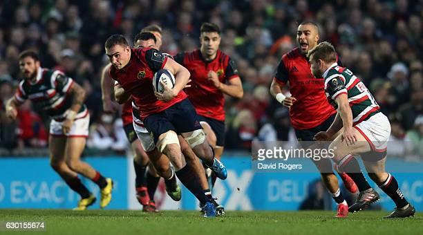 Tommy O'Donnell of Munster runs with the ball during the European Rugby Champions Cup match between Leicester Tigers and Munster at Welford Road on...