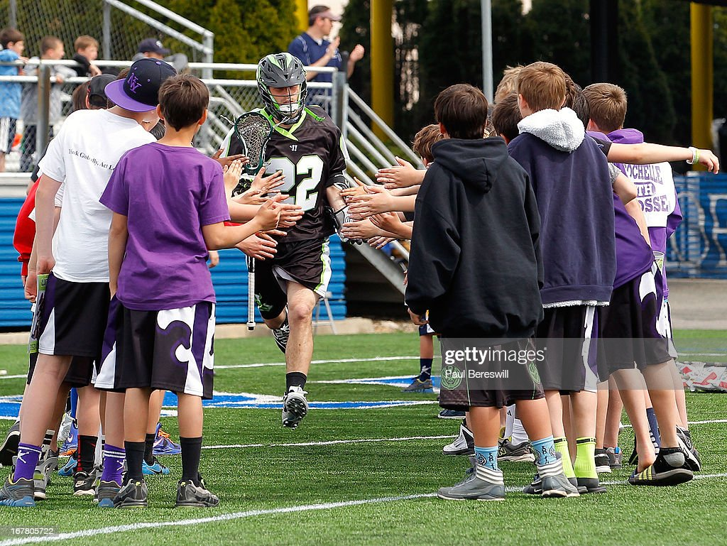 Tommy Palasek #22 of the New York Lizards runs onto the field as he is introduced perior to a Major League Lacrosse game against the Boston Cannons at James M. Shuart Stadium on April 28, 2013 in Hempstead, New York.