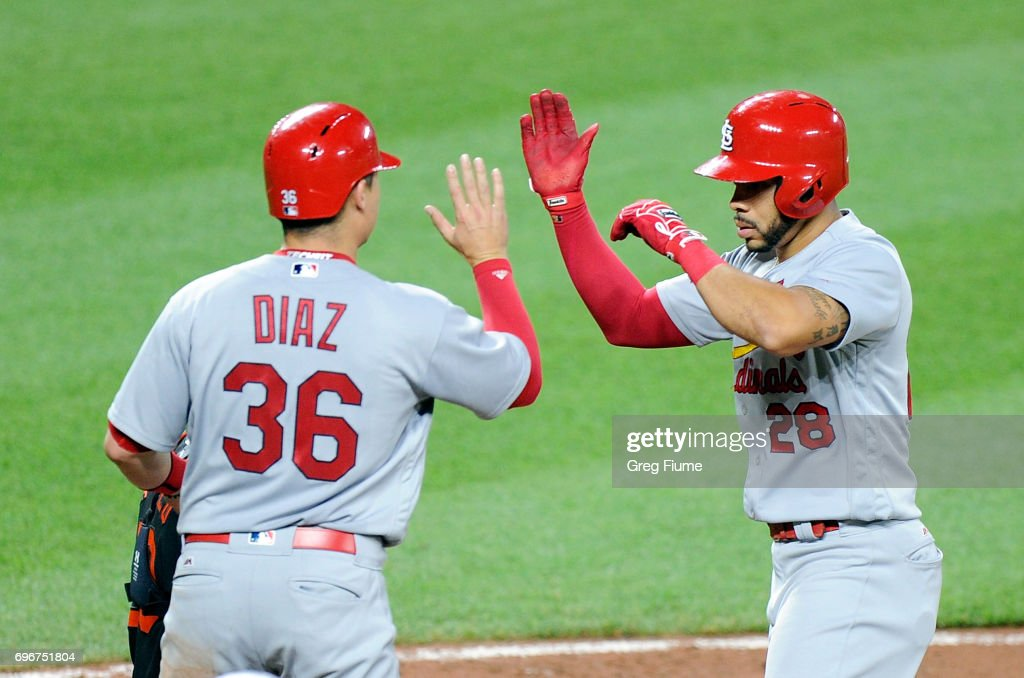 Tommy Pham #28 of the St. Louis Cardinals celebrates with Aledmys Diaz #36 after hitting a home run in the seventh inning against the Baltimore Orioles at Oriole Park at Camden Yards on June 16, 2017 in Baltimore, Maryland. St. Louis won the game 11-2.