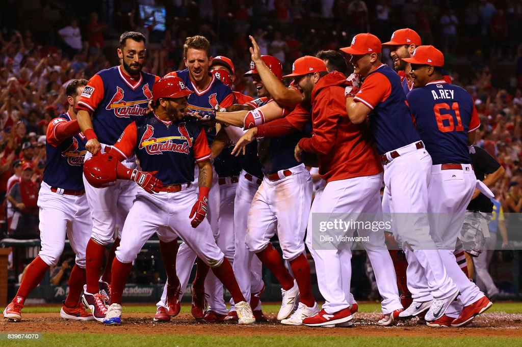 Tommy Pham #28 of the St. Louis Cardinals celebrates with his teammates after hitting a two-run walk-off home run against the Tampa Bay Rays in the ninth inning at Busch Stadium on August 26, 2017 in St. Louis, Missouri.