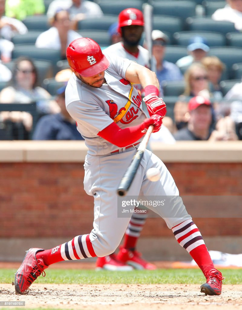 Tommy Pham #28 of the St. Louis Cardinals follows through on a sixth inning RBI double against the New York Mets on July 20, 2017 at Citi Field in the Flushing neighborhood of the Queens borough of New York City.