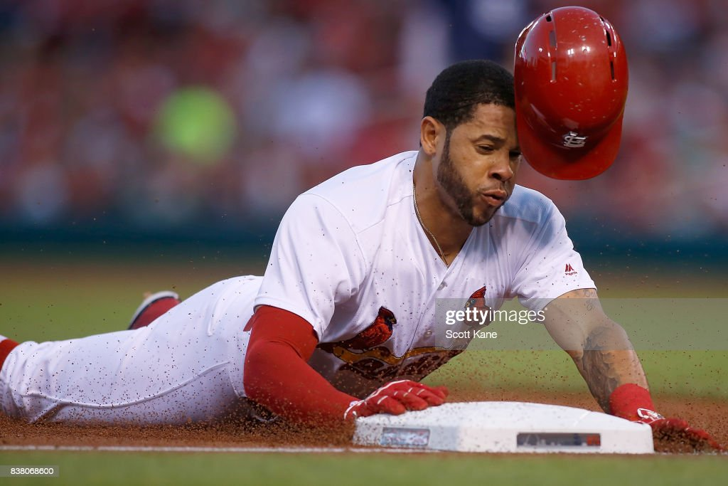 Tommy Pham #28 of the St. Louis Cardinals slides safely into third base during the first inning against the San Diego Padres at Busch Stadium on August 23, 2017 in St. Louis, Missouri.