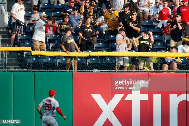 Tommy Pham of the St Louis Cardinals watches a home run leave the field in the second inning against the Pittsburgh Pirates at PNC Park on August 19...