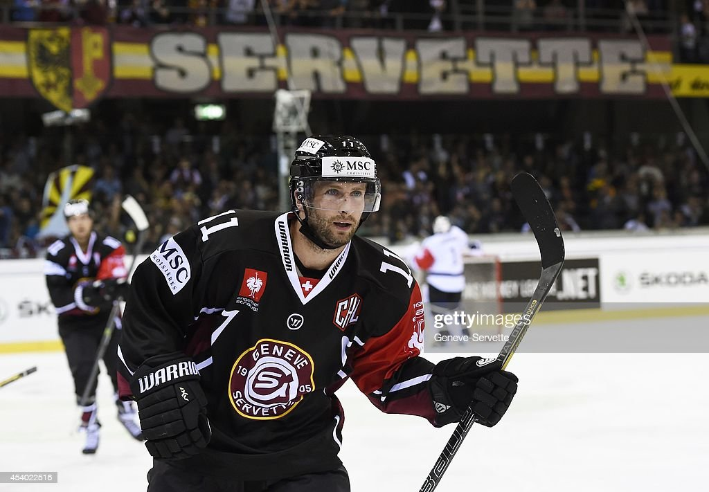 Tommy Pyatt # 11 of Geneve-Servette celebrates after his goal during the Champions Hockey League group stage game between Geneve-Servette and Villach SV on August 23, 2014 in Geneva, Switzerland.