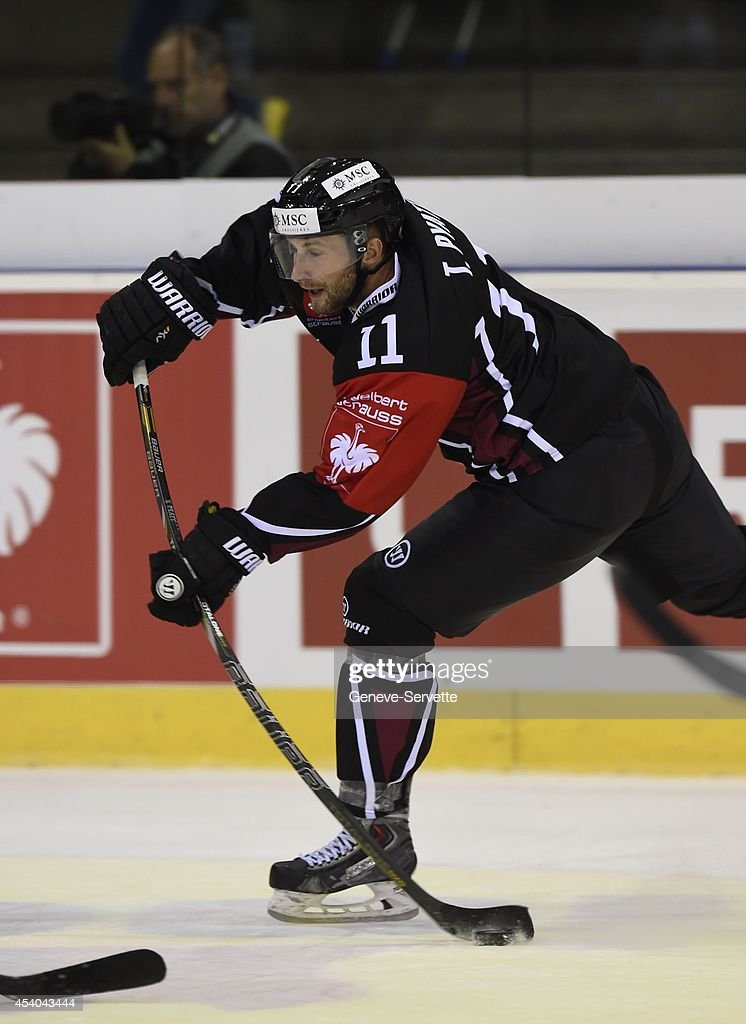Tommy Pyatt of Geneve-Servette hits a slap shot during the Champions Hockey League group stage game between Geneve-Servette and Villach SV on August 23, 2014 in Geneva, Switzerland.