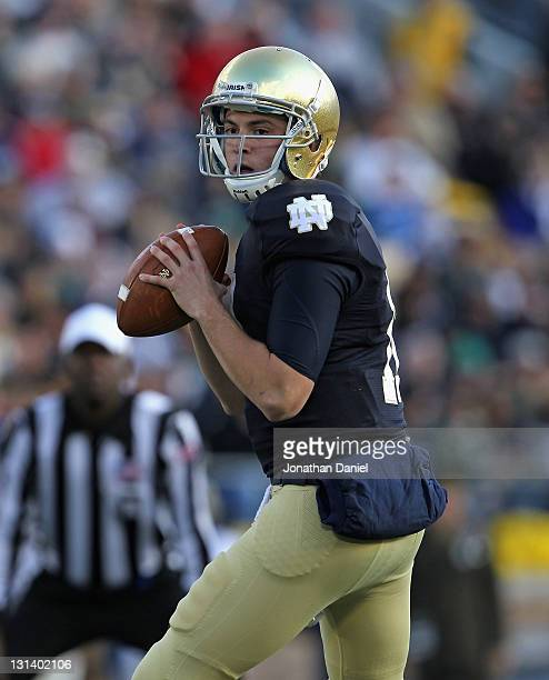 Tommy Rees of the Notre Dame Fighting Irish looks for a receiver against the Navy Midshipmen at Notre Dame Stadium on October 29 2011 in South Bend...