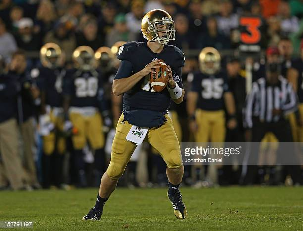 Tommy Rees of the Notre Dame Fighting Irish looks for a receiver against the Michigan Wolverines at Notre Dame Stadium on September 22 2012 in South...