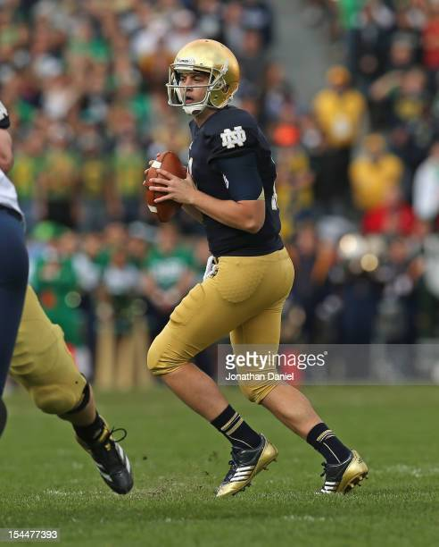 Tommy Rees of the Notre Dame Fighting Irish looks for a receiver against the BYU Cougars at Notre Dame Stadium on October 20 2012 in South Bend...