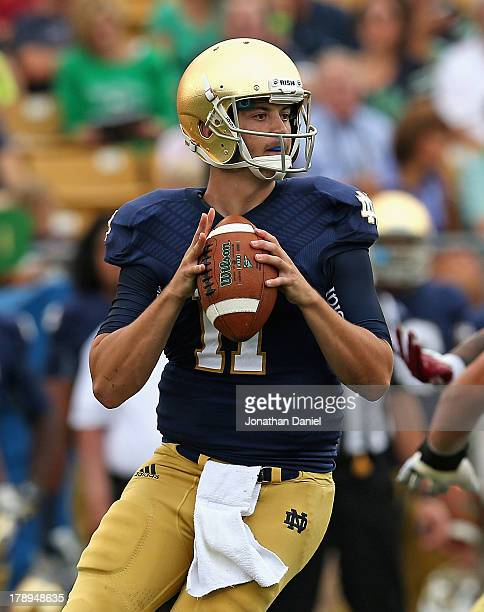 Tommy Rees of the Notre Dame Fighting Irish looks for a receiver against the Temple Owls at Notre Dame Stadium on August 31 2013 in South Bend Indiana